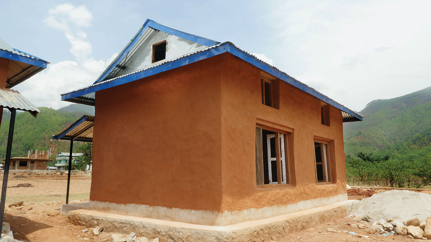 A completed Earthbag home with traditional adobe plaster.